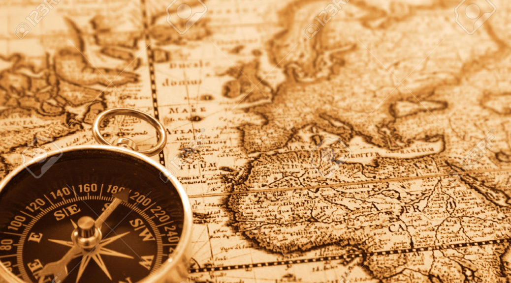 1658365-compass-on-old-map-Stock-Photo
